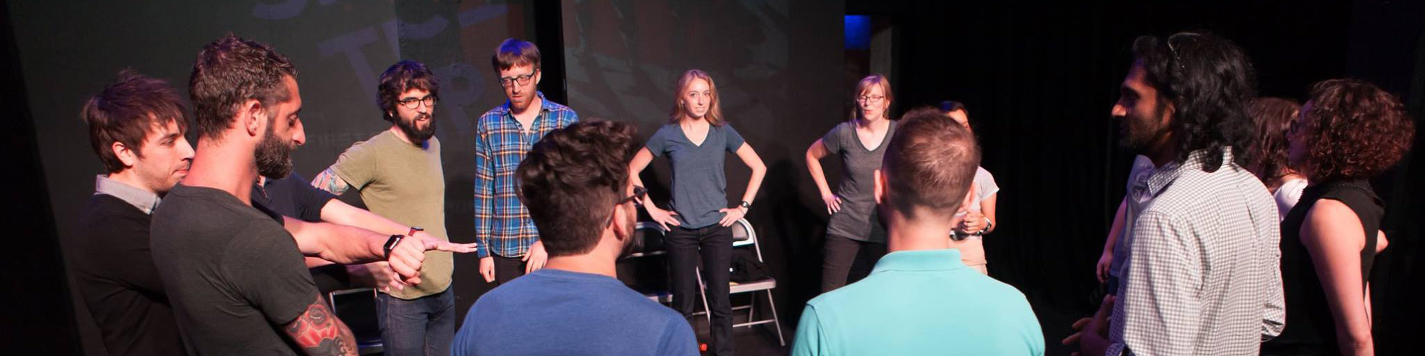improvisers standing in a circle